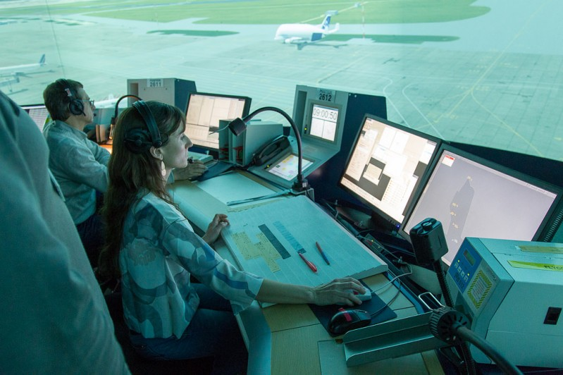a woman is in front of her computer and uses software to get the planes